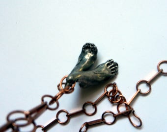 pewter feet on long copper chain necklace