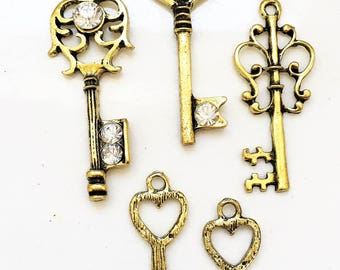 new stock antiqued gold tone metal key charms--mixed lot of 5
