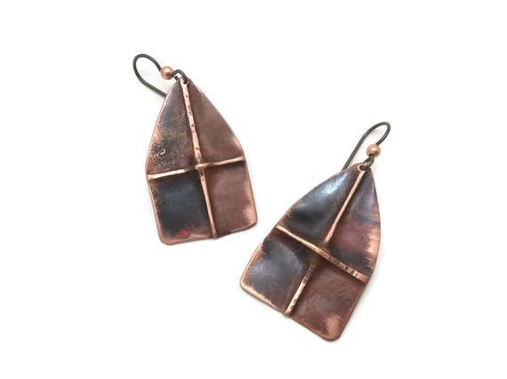 Hand hammered copper shield earrings