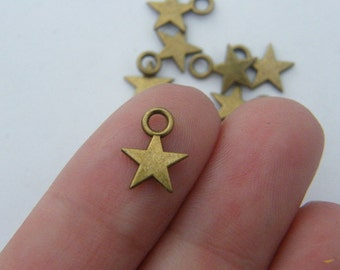 18 Star charms antique bronze tone BC267