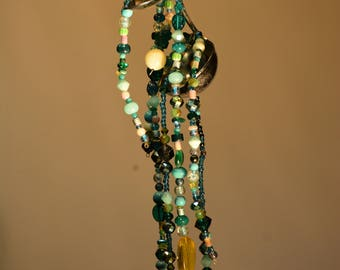 This is a water dripper. Shines in sunlight. Colors of aquas. Also a sun catcher.