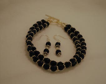 black pressed glass double strand bracelet and earringings