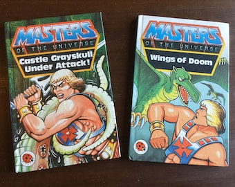 Two masters of the universe He man books. Castle grayskull under attack and wings of doom