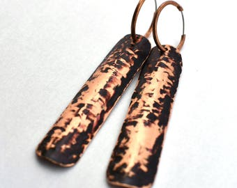Hammered copper hoop earring with black patina