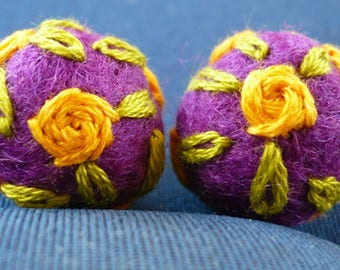 set of two felted wool beads, embroidered in yellow and green. approximately 18mm