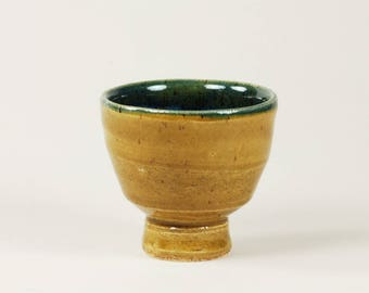 Amber and blue ceramic cup