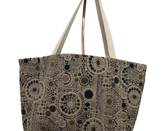 Small brown circle upholstered tote