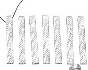 Set of ten ± 40 decorated metal pendants/charms x 4, 5mm (eye ± 4mm)