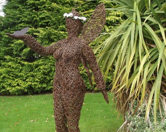 Lifesize Handcrafted Willow Fairy Sculpture .
