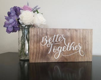 Calligraphy wood better together sign