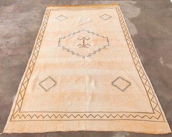 "Moroccan orange-sorbet cactus silk ""sabra"" rug, embroidered with Berber tribal designs"