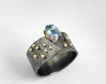 A wide band ring of oxidized silver, studded gold granules and a gem,Aquamarine ring, Gold silver ring.