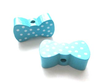 Wooden bow - Turquoise with white dots bead