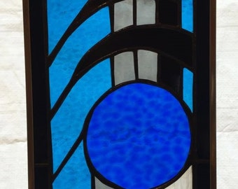 Cobalt blue and black stained glass window hanging
