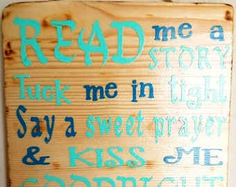 Little boys Read me a story sign.