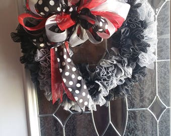 Wreath: Red and black with ribbon