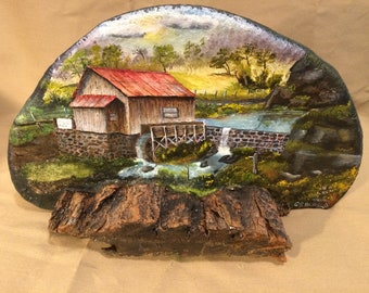 This is a OLE MILL painting on a piece of bracket fungus from a locust tree.