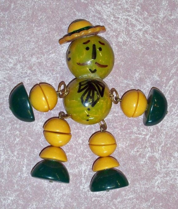 Really Cute Crib toy style Bakelite Man Pin