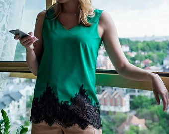 Green silk blouse with lace.