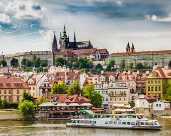 Photo of Vltava Prague river. View on Gothic cathedral St.Vitus. Old Prague ,clouded sky.