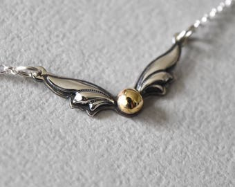 Magical Winged Ball Sterling Silver Necklace.