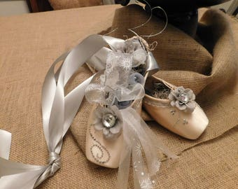 Decorated Silver Pointe Shoes