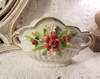 Double handle floral cache pot with applied flowers
