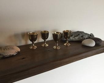 Four vintage brass Indian goblets
