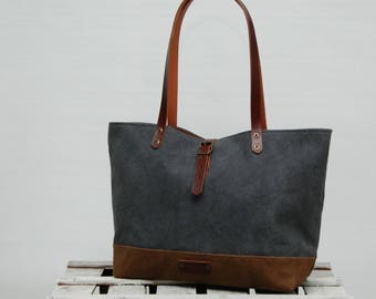 waxed Waxed canvas  bag , gunmetal gray color,brown ,with leather handles and closures,hand wax