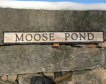 Moose Pond sign with a rustic vintage appearance