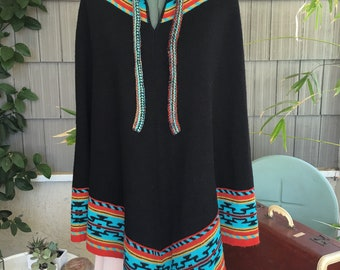 Poncho sweater with southwestern accent
