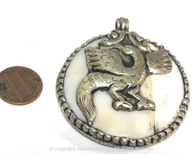 1 pendant - Large bold Tibetan Silver Repousse tribal naga conch shell pendant with tibetan eagle phoenix bird carving  - PM490C