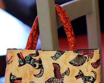 Small tote made with 100% cotton Pacific Northwest Totem Animals print/interior lining/piped handles