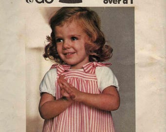 """Butterick 4782 Pinafore jumper gathered bands with shoulder ties over tshirt outfit Size 4 Breast 23"""" (uncut) sewing pattern"""