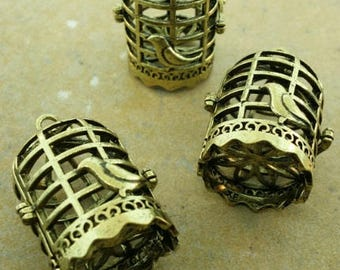 Brass bird with cage pendant