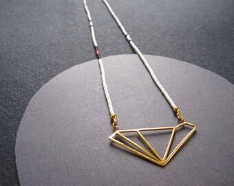 24ct gold vermeil asymmetric diamond pendant on fine grey, blue, black and pink glass beads