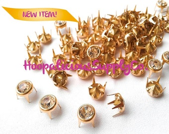 25pc 4mm Gold Metal Prong Studs w/Silver Rhinestones .DIY Clothing. Shoes. Accessories. Fast Shipping from USA w/Tracking 4 Domestic Orders.