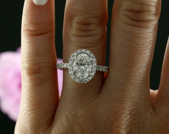 9x7mm Oval Forever Brilliant Moissanite and Diamond Halo Engagement Ring in 14k White Gold (avail. in rose, white, yellow gold and platinum)