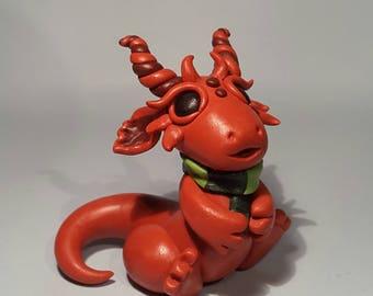 Orange and brown polymer clay dragon. Autumn, scarf, green, leaf.