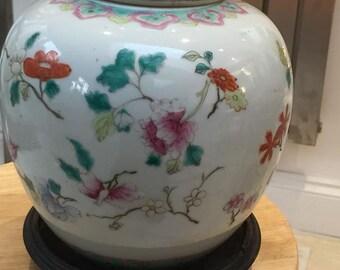 A large Antique Chinese Famile Rose Jar