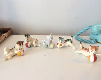 5 vintage porcelain cats playing ball