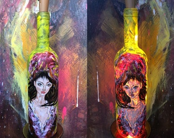 Handmade paintings on bottles which can be used as decorative lights