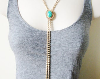 Vintage Avon  gold and  green Victorian style bolero with tassels (J5)
