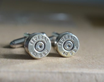 Bullet cufflinks fashioned from repurposed nickel silver Federal .40 S&W shell casings