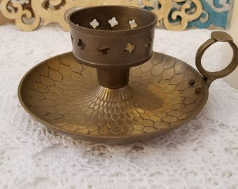 Solid brass candle holder with thumb ring