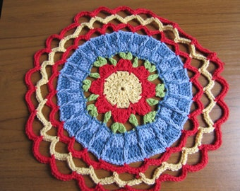 Pretty Poppy crochet mandala in red, yellow, blue and green