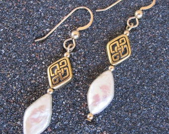 Diamond-shaped peach freshwater pearl and Celtic bead earrings with gold-filled earwires and accent beads.