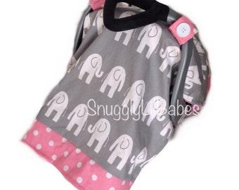 Pink polka dot car seat canopy with grey elephants