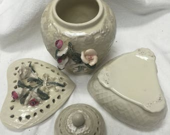 Decorative ceramic urn and heart shaped box