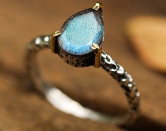 Labradorite teardrop ring in silver bezel and brass prongs setting with sterling silver oxidized texture band
